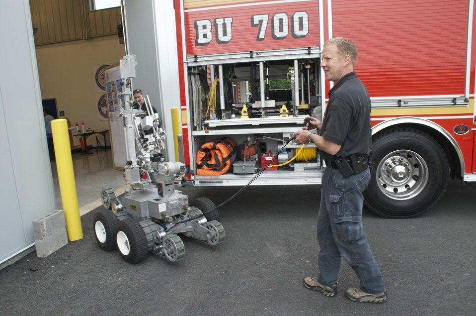 Robot and Bomb Squad Member